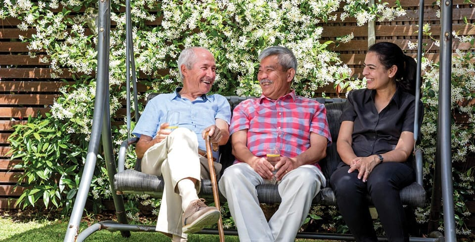 Arcare Home Care Sitting In Garden With Friend